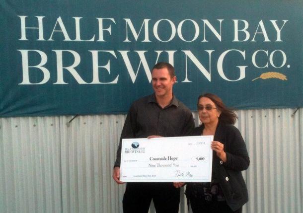 Nate Rey presents $9,000 donation check to Fatima Soares