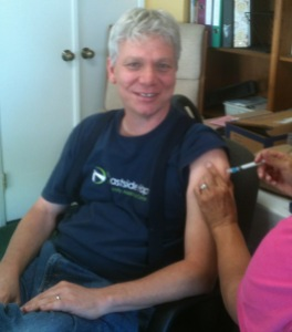 Community Development Director Keith Terry getting his Free Flu Shot from a San Mateo County health nurse